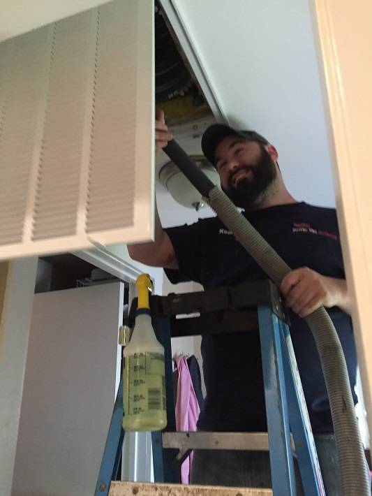 Power Vac America crew member performing air duct cleaning Houston TX