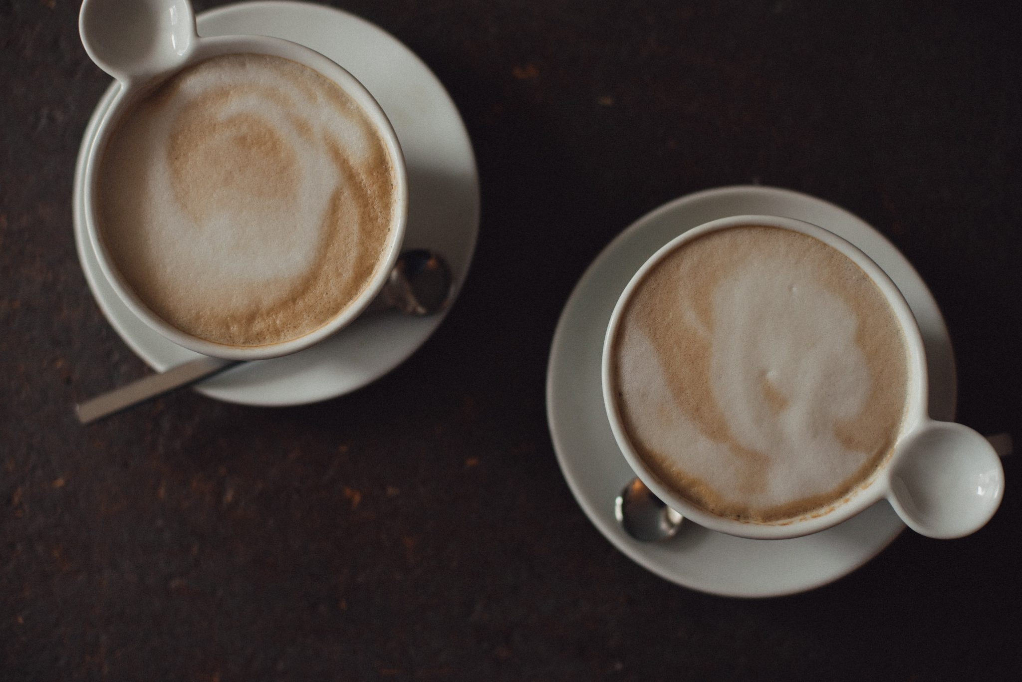 two cups of coffee latte viewed from above frothy